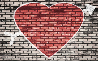 Valentines Day background and  love of symbol on brick wall