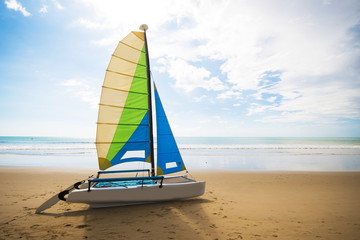 colorful sailing boat on the beach