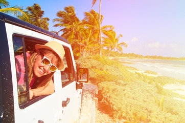 happy woman travel by car on tropical beach