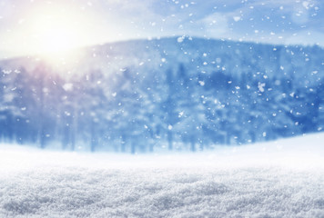 Winter background, falling snow over mountain landscape