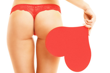 Midsection of woman's buttocks and a heart