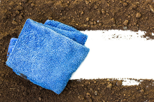 rag wiping a soil on white background