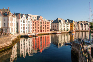 Trondheim, Norway. Multicolored houses in the river bank are ref