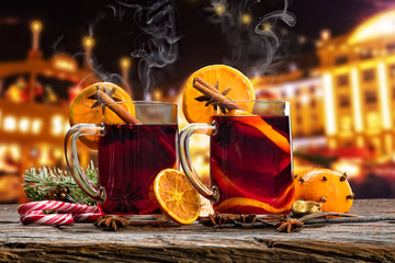 Hot red wine drinks on wooden table