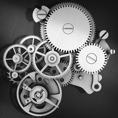 Grey metal cog gears joining together