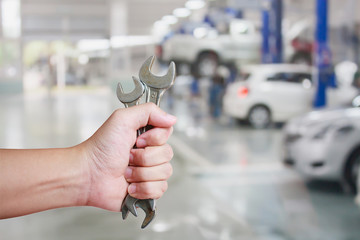 Hand of professional Auto mechanic with wrench