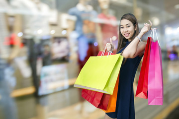 happiness, consumerism, sale and people concept - smiling young