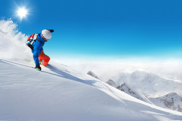 Man skier running downhill