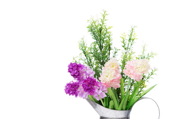 A bouquet of artificial  flowers in galvanize can isolated  on w