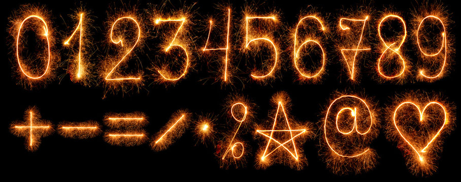 Numbers and other symbols of sparklers isolated on black