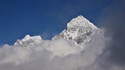 Peak of Mt Thamserku surrounded by clouds