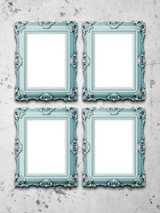 Four baroque frames on concrete wall background