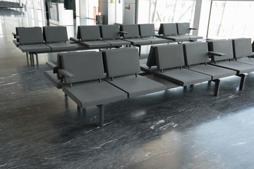 row of  chairs at airport