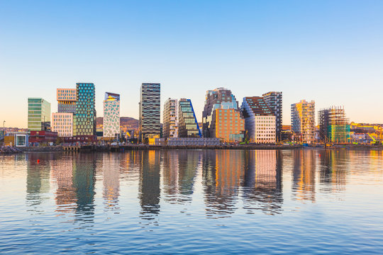 Modern buildings in Oslo with their reflection into the water