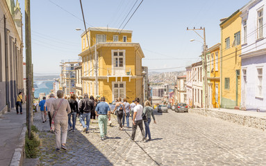 VALPARAISO - NOV 13, 2015: Street full of visitors in Valparaiso, declared a UNESCO World Heritage Site in 2003. Valparaiso, Chile