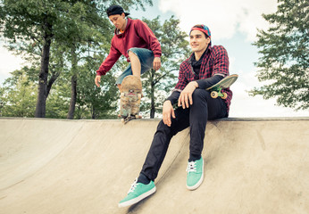 Two skaters practicing at the skate park