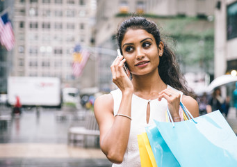 Young american woman making shopping in New york city