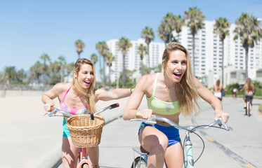 Twin sisters going on the bicycle in Venice beach