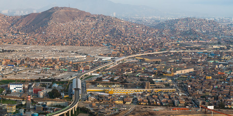 Panoramic view of Lima City from San Cristobal hill to El Agustino town.