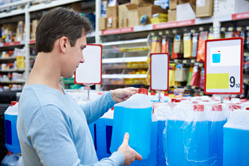 Man buys nonfreezing liquid in supermarket