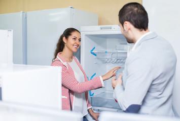 Family buying domestic refrigerator