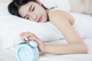 young woman sleeping on bed f