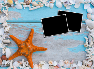 Picture frames and starfish,sea shells border on grunge wooden b