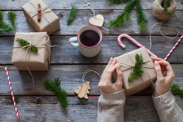 girl decorates the christmas gifts in a scandinavian style