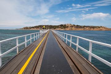 bridge over sea between land to  island