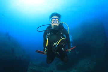 Young woman scuba diver