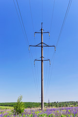 High-voltage electric pole with wires on a background of blue sk