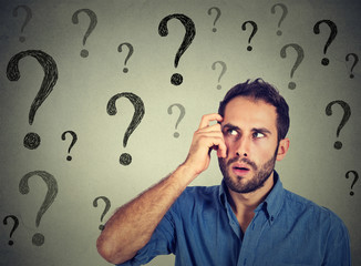 Thoughtful confused handsome man has too many questions and no answer