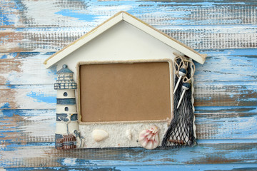 Photo frame on wooden background - summer frame
