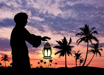 Silhouette of  man with  lamp in  hand