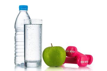 Dumbbells, fresh green apple and bottle of water on white. Healt