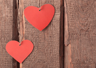 vintage red hearts on wooden background