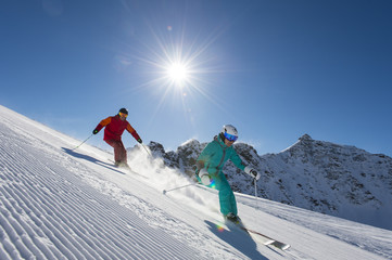 downhill skiing in behind the sun