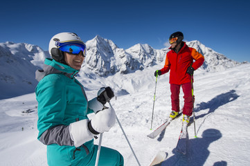 skiers makes a break and enjoy the view