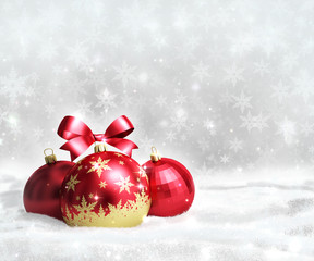 Christmas and new year greeting card with red balls on snow and space for text