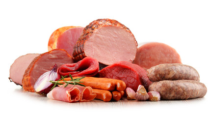 Meat products including ham and sausages isolated on white