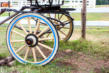 Part of ancient cart with wooden wheels