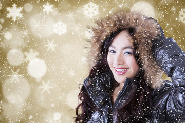 Cute girl with winter jacket and winter background