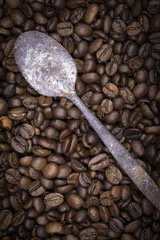 Coffee beans and old spoon still life