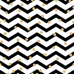 Chevron zigzag black and white seamless pattern with golden shimmer polka dots