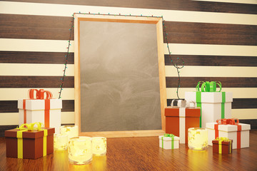 Blank picture frame with christmas gift boxes and lit candles