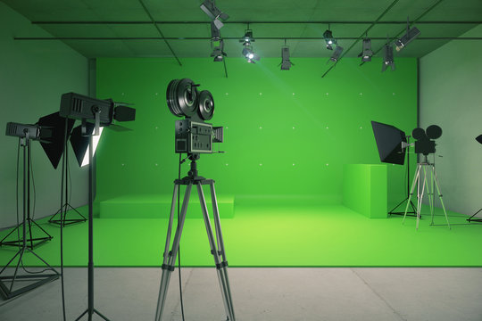Modern empty green photo studio with  old style movie camera