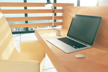 Wood style work space with laptop and coffee mug