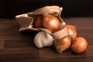 Jute bag with onions and garlic
