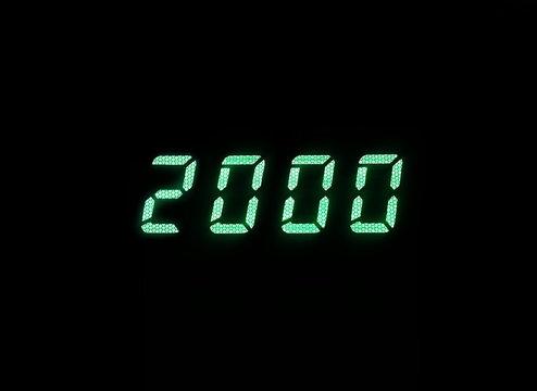 Horizontal green digital 2000 millenium display clock memories b