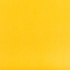 dark yellow colored square sheet of paper